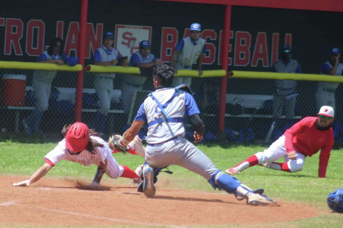 A moment before the electrifying tag at the plate, Trojan head coach Tyler Iguess is nearly on the ground, watching the play unfold. The Channelview catcher already has the ball with Robertson still a few feet from reaching home plate.