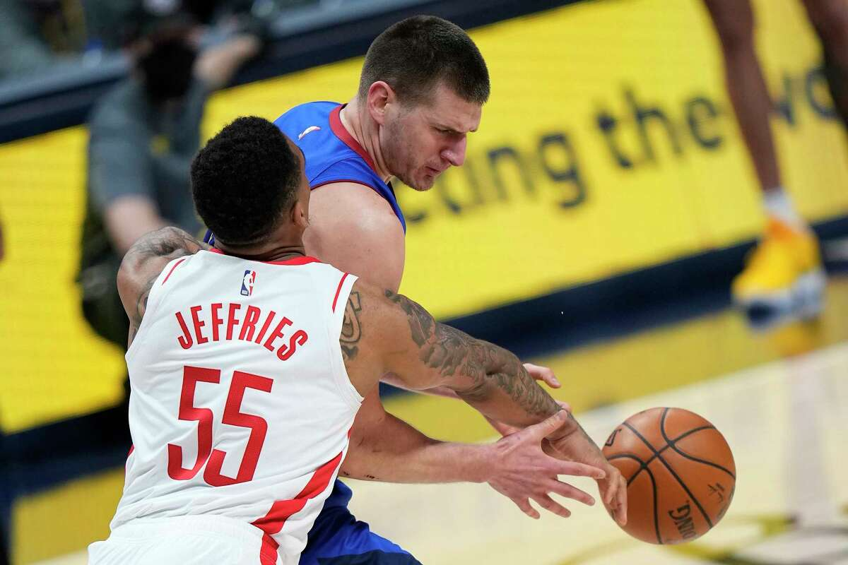 Denver Nuggets center Nikola Jokic (15) looses the ball under pressure form Houston Rockets forward DaQuan Jeffries (55) during the first half of an NBA basketball game Saturday, April 24, 2021, in Denver. (AP Photo/Jack Dempsey)