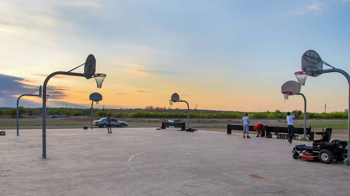 Laredoans take shots at the Los Martinez basketball courts on April 21. The court was built with public money on private land nearly a decade ago, and officials are trying to secure its rights for the future.