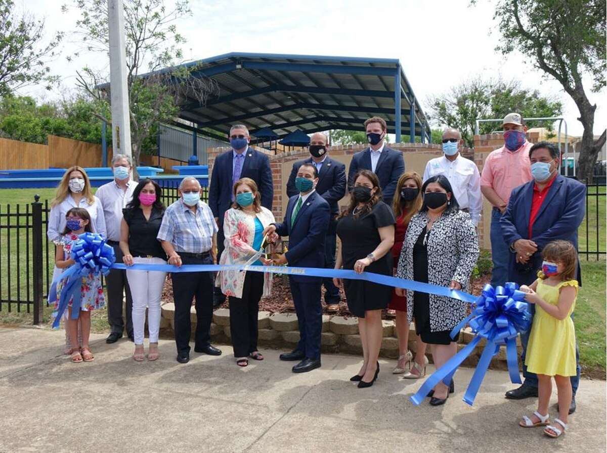 """Cynthia Collazo Park was inaugurated by the City of Laredo and Councilmember Alberto Torres Jr. on Friday. Pictured: Front row: Olivia Brayfield; Texas Parks & Wildlife Commissioner, Anna Galo; Webb County Commissioner for Precinct 3, John Galo; Larcy Brayfield; Juan Collazo; Honoree, Cynthia Collazo; District 4 Council Member, Alberto Torres, Jr.; Melina Bermudez; Assistant City Manager, Kristina L. Hale; Deputy City Manager, Rosario Cabello; LISD Board President, Hector """"Tito"""" Garcia; Maddie Brayfield. Back row: City Secretary, Jose Valdez; Council Member for District 5, Ruben Gutierrez, Jr.; Representing Congressman Henry Cuellar, Eric Cleveland; Assistant City Manager, Riazul Mia; Council Member for District 2, Vidal Rodriguez."""