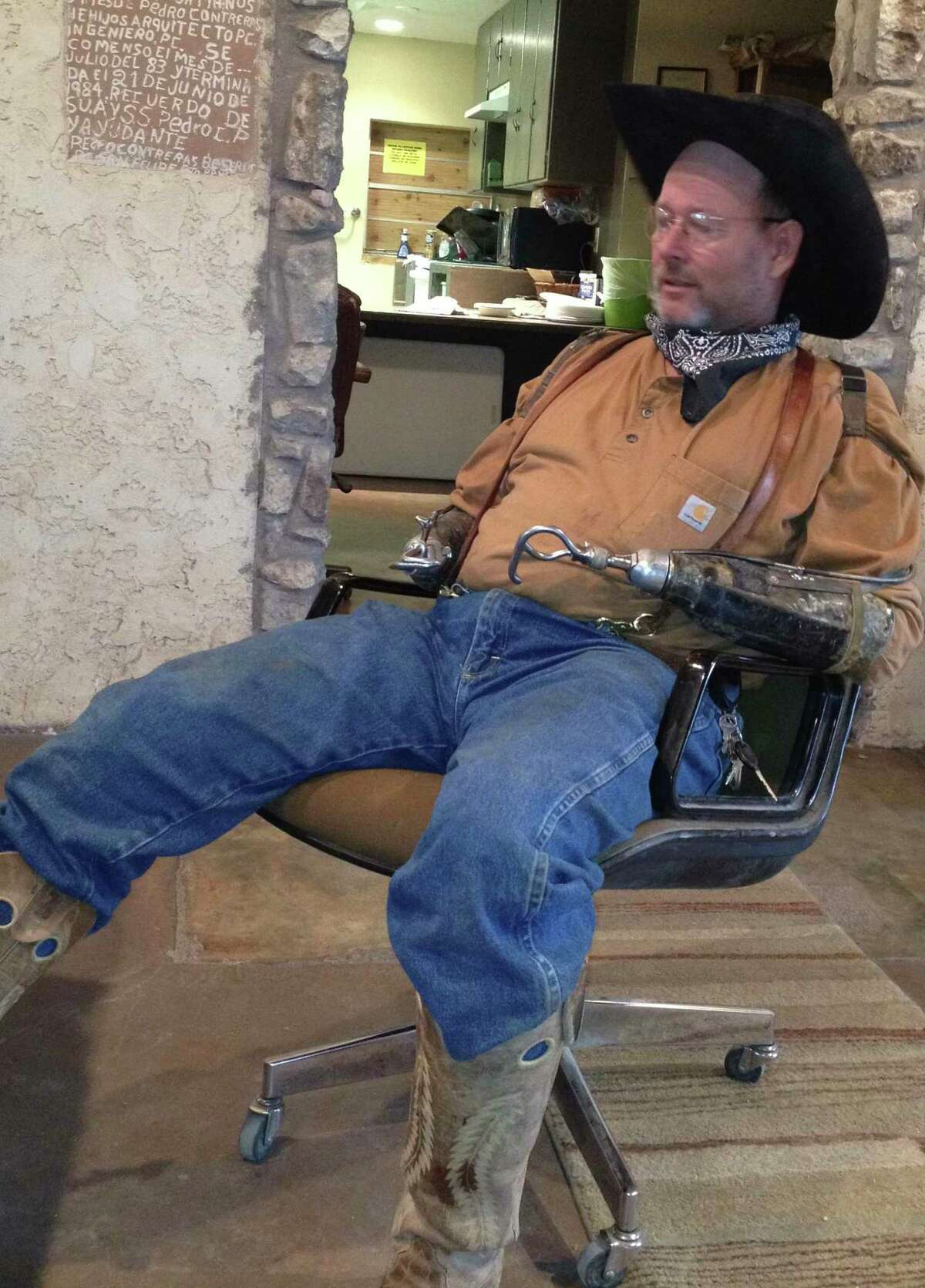 Charlie Bowers of Knickerbocker is a real Texas cowboy, despite losing both hands in an electrical accident.