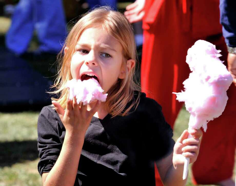 Kennedy Reeds, 6, of Newtown, eats cotton candy during A Taste of Danbury on the CityCenter Green, Saturday, Sept. 11, 2010. Photo: Michael Duffy / The News-Times