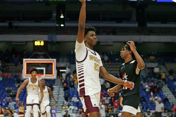After Beaumont United Terrance Arceneaux #23 hit a three point shot inOT, Dallas Kimball Ronald Gustus #11 walks off the court. UIL boys Class 5A basketball state championship game on Friday, March 12, 2021 at the Alamodome.