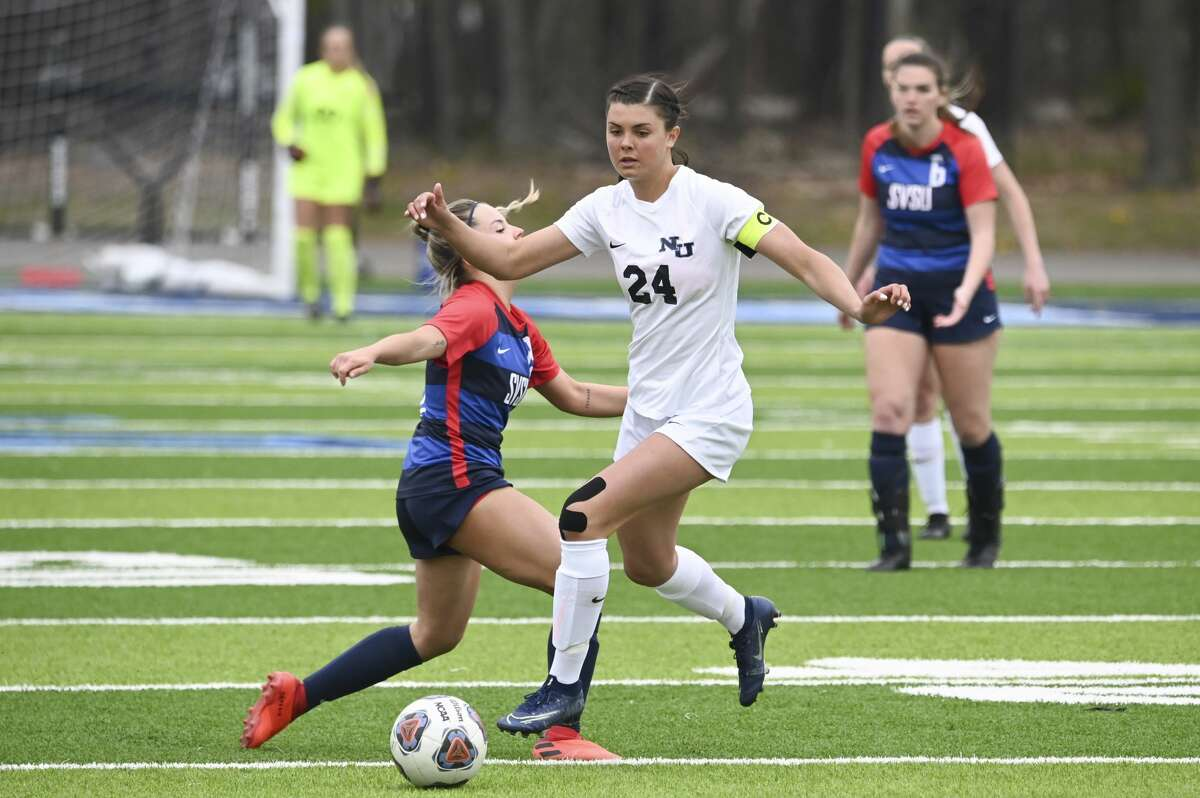Northwood University's Jessica Piper dribbles down the field during the Timberwolves' game against Saginaw Valley State University Saturday, April 24, 2021 at Northwood. (Adam Ferman/for the Daily News)