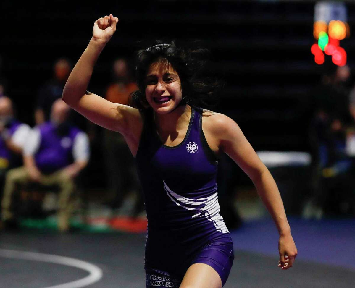 Brittany Cotter of Katy Morton Ranch reacts after defeating Jocelyn Lass of Austin Westlake in a 110-pound bout during the UIL State Wrestling Championships, Saturday, April 24, 2021, in Cypress.