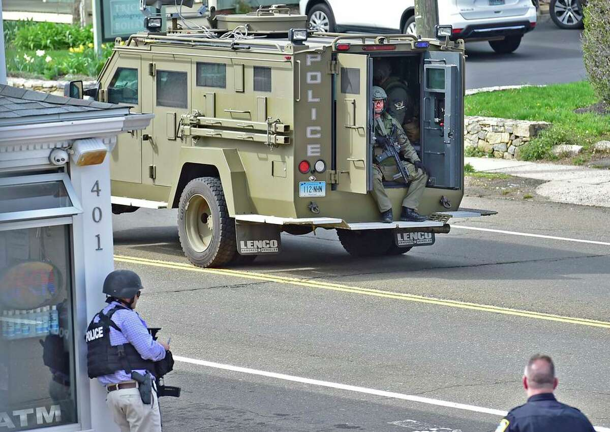 New Haven Police Emergency Services Unit driving to an active shooter scene on Main Street in Branford, April 13, 2021.