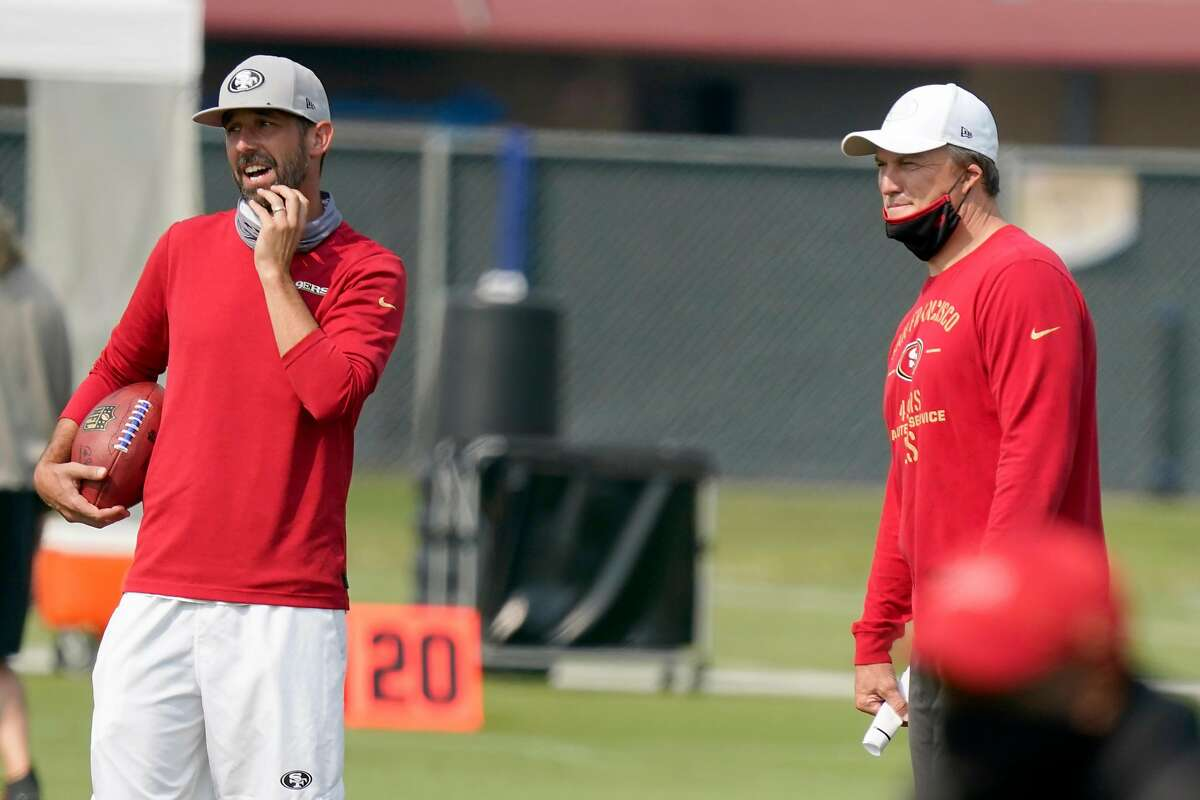 Kyle Shanahan (left) and John Lynch considered six QBs - including Aaron Rodgers - before settling on Trey Lance.