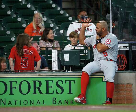 Los Angeles Angels Albert Pujols (5) chats with fans before the start of the first inning of an MLB baseball game at Minute Maid Park, Sunday, April 25, 2021, in Houston. Photo: Karen Warren, Staff Photographer / @2021 Houston Chronicle