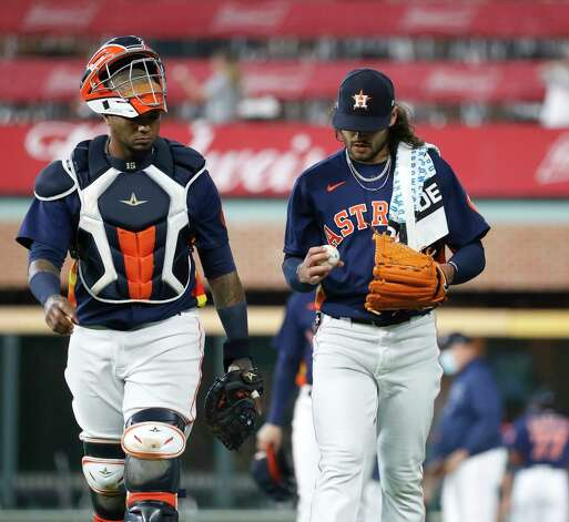 Houston Astros starting pitcher Lance McCullers Jr. (43) walks out of the bullpen with Hcatcher Martin Maldonado (15) before the start of the first inning of an MLB baseball game at Minute Maid Park, Sunday, April 25, 2021, in Houston. Photo: Karen Warren, Staff Photographer / @2021 Houston Chronicle