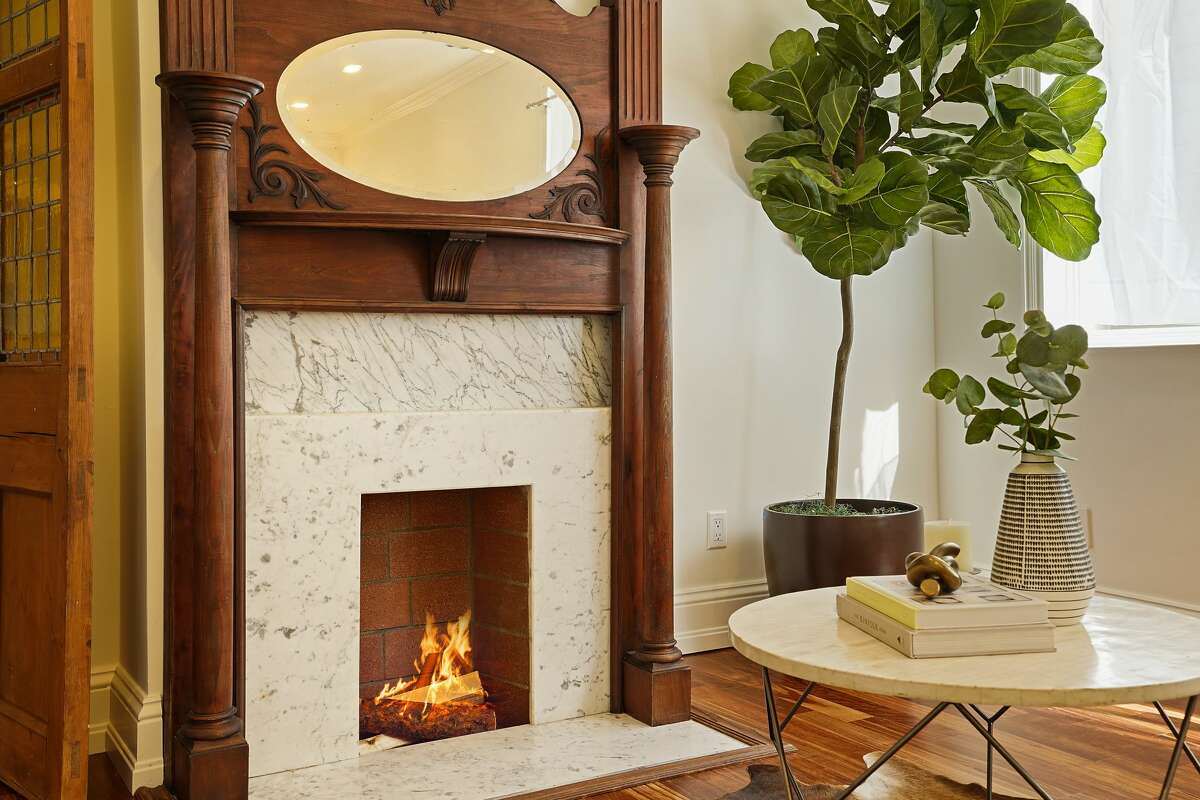 A charming fireplace warms the living room.