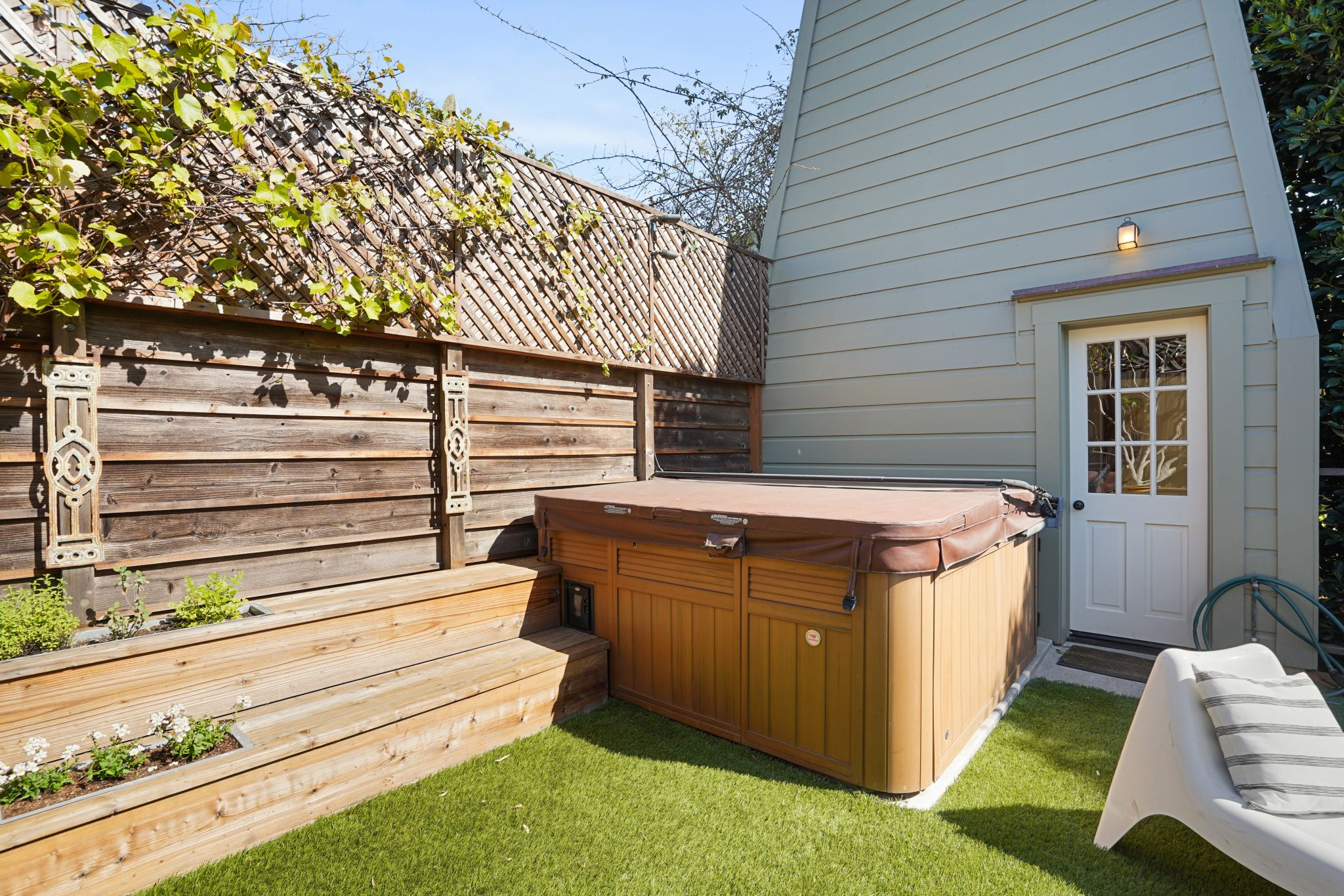 The backyard also includes a hot tub.