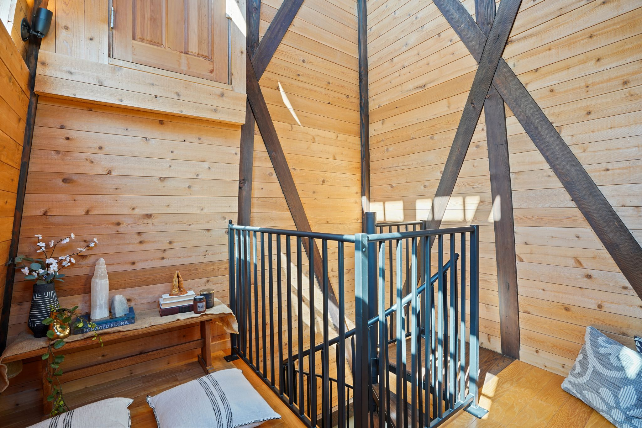 Inside the water tower, exposed beams create a rustic effect.