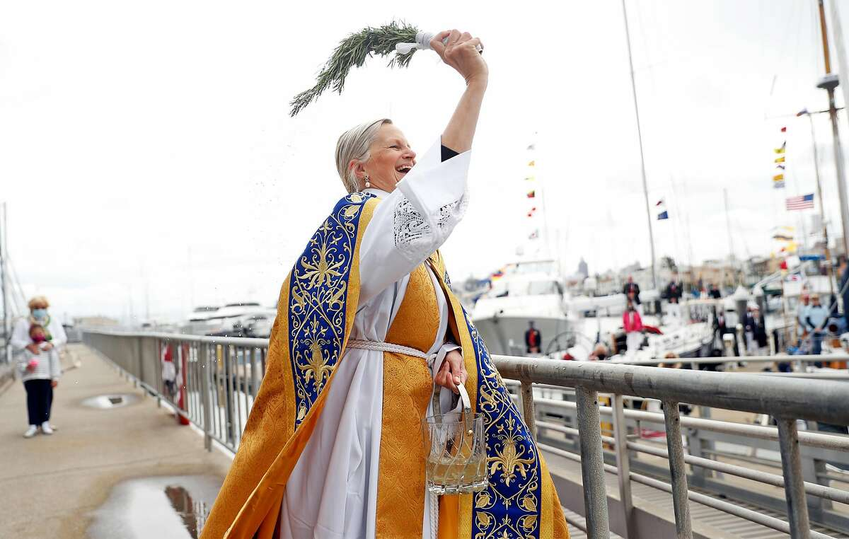 The Rev. Christine Trainor blesses the fleet on opening day of sailing season at St. Francis Yacht Club in San Francisco.