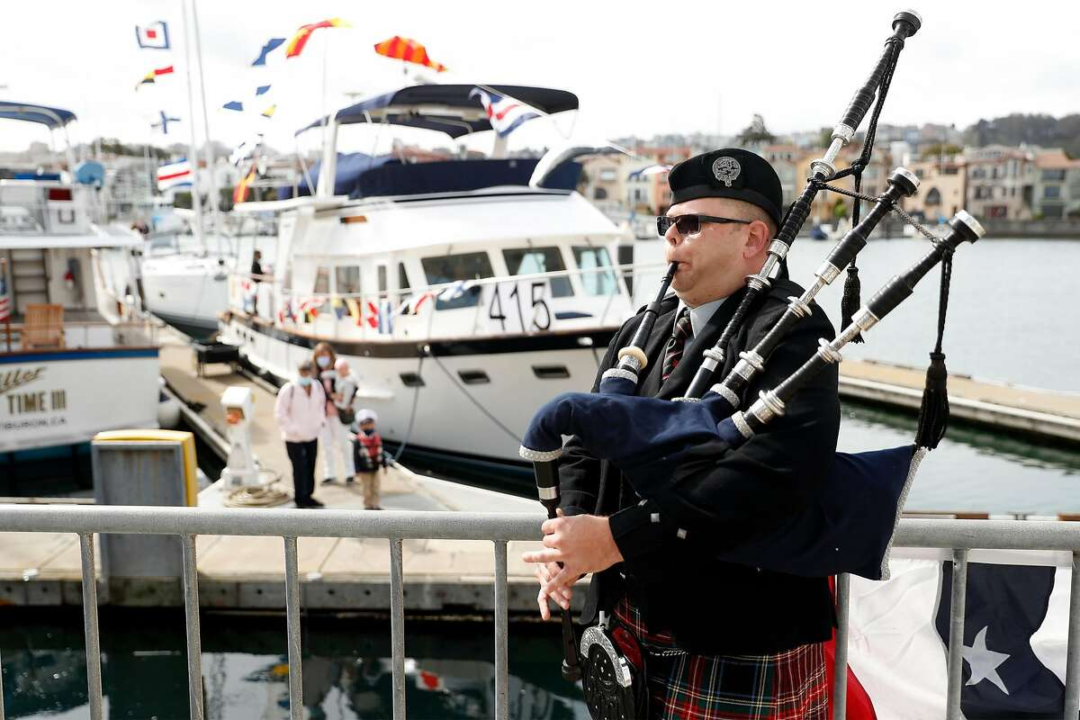 Steven McElhaney of the Prince Charles Pipe Band in South San Francisco plays the bagpipes on opening day of sailing season at St. Francis Yacht Club in San Francisco on Sunday.