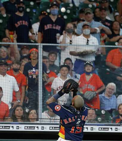 Houston Astros catcher Martin Maldonado (15) catches Los Angeles Angels Jose Rojas' pop out near the dugout during the third inning of an MLB baseball game at Minute Maid Park, Sunday, April 25, 2021, in Houston. Photo: Karen Warren, Staff Photographer / @2021 Houston Chronicle