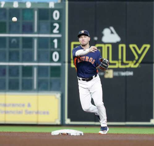 Houston Astros third baseman Alex Bregman (2) makes the throw to first as Los Angeles Angels Shohei Ohtani ground out during the fourth inning of an MLB baseball game at Minute Maid Park, Sunday, April 25, 2021, in Houston. Photo: Karen Warren, Staff Photographer / @2021 Houston Chronicle