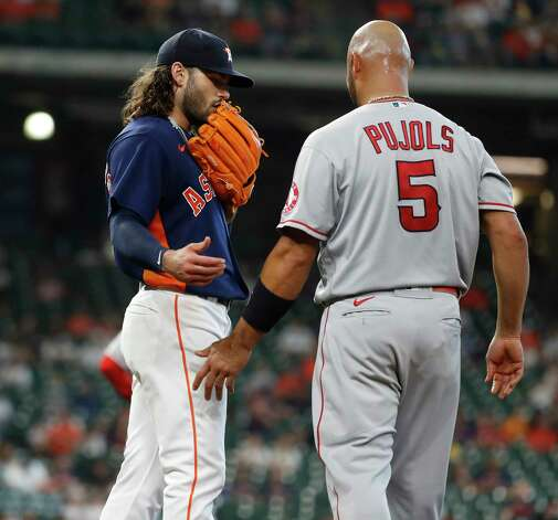 Houston Astros starting pitcher Lance McCullers Jr. (43) walks over to talk with Los Angeles Angels Albert Pujols  after the sixth inning of an MLB baseball game at Minute Maid Park, Sunday, April 25, 2021, in Houston. Photo: Karen Warren, Staff Photographer / @2021 Houston Chronicle