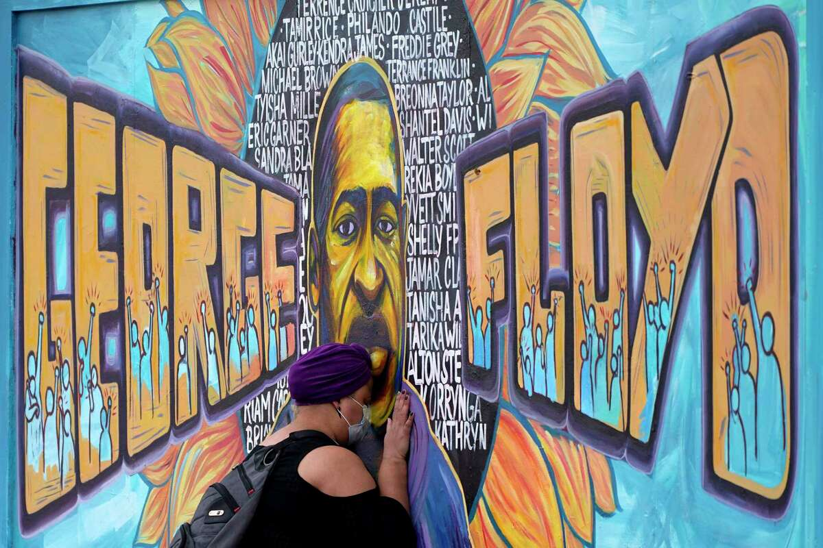 Damarra Atkins paid her respects to George Floyd at a mural at George Floyd Square on Friday, April 23, 2021 in Minneapolis.