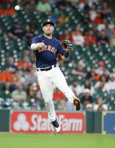 Houston Astros third baseman Alex Bregman (2) makes the throw to first base as Los Angeles Angels Anthony Bemboom ground out during the seventh inning of an MLB baseball game at Minute Maid Park, Sunday, April 25, 2021, in Houston. Photo: Karen Warren, Staff Photographer / @2021 Houston Chronicle