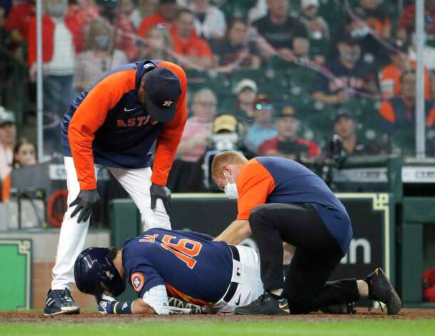 Houston Astros manager Dusty Baker Jr. and a trainer check on Aledmys Diaz (16) after he fouled the ball off his leg during the seventh inning of an MLB baseball game at Minute Maid Park, Sunday, April 25, 2021, in Houston. Photo: Karen Warren, Staff Photographer / @2021 Houston Chronicle