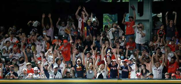 Fans do the wave during the seventh inning of an MLB baseball game at Minute Maid Park, Sunday, April 25, 2021, in Houston. Photo: Karen Warren, Staff Photographer / @2021 Houston Chronicle