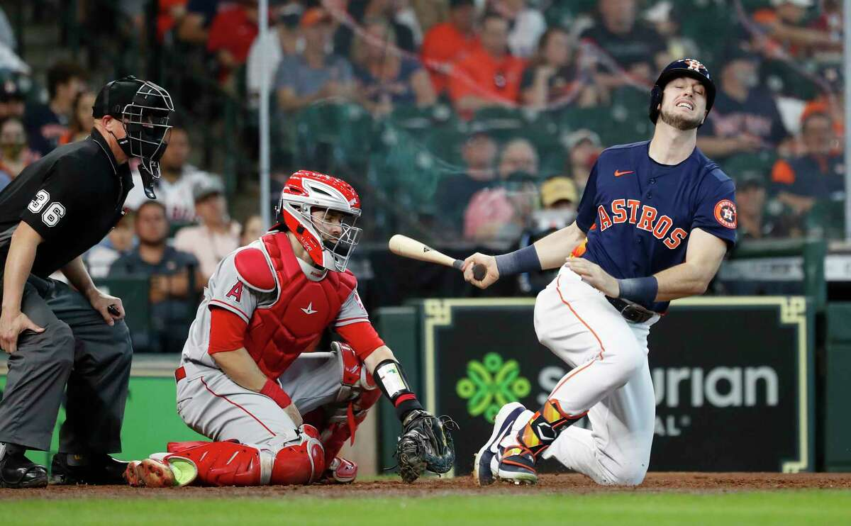 Houston Astros Kyle Tucker (30) crumples to the ground as he chased a strike by Los Angeles Angels Chris Rodriguez during the seventh inning of an MLB baseball game at Minute Maid Park, Sunday, April 25, 2021, in Houston.