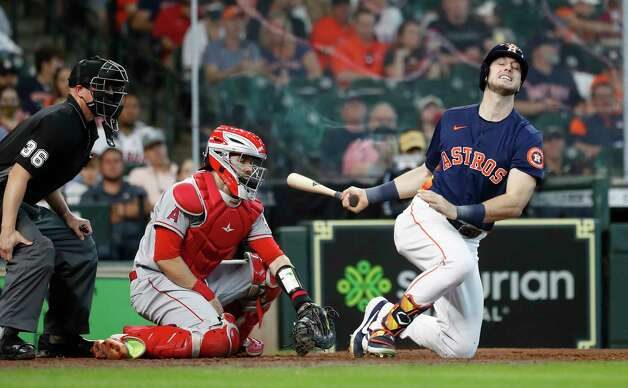 Houston Astros Kyle Tucker (30) crumples to the ground as he chased a strike by Los Angeles Angels Chris Rodriguez during the seventh inning of an MLB baseball game at Minute Maid Park, Sunday, April 25, 2021, in Houston. Photo: Karen Warren, Staff Photographer / @2021 Houston Chronicle