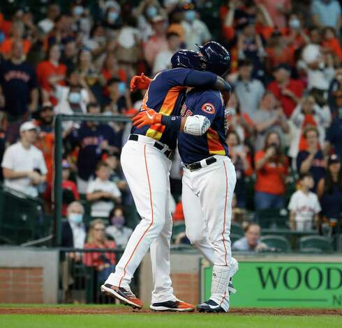 Houston Astros Yuli Gurriel (10) hugs Yordan Alvarez (44) after his two-run home run tied the game with the Los Angeles Angels during the seventh inning of an MLB baseball game at Minute Maid Park, Sunday, April 25, 2021, in Houston. Photo: Karen Warren, Staff Photographer / @2021 Houston Chronicle