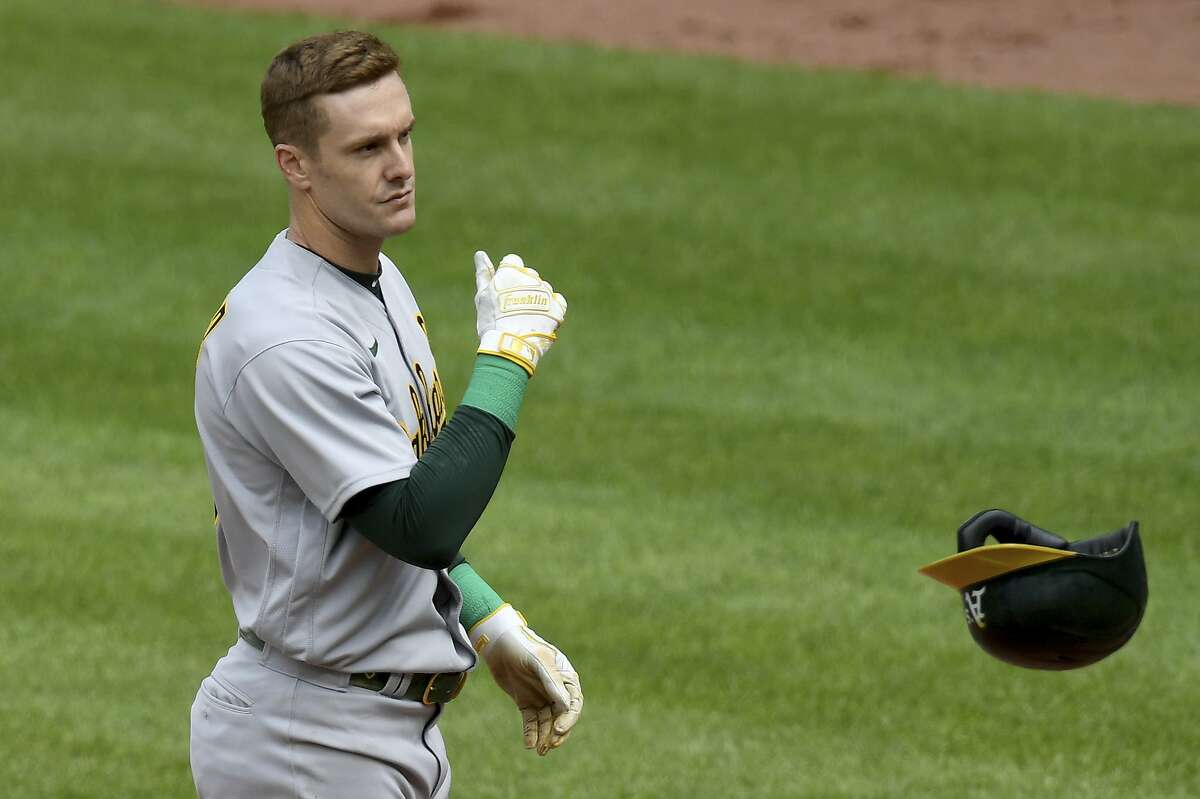 Left fielder Mark Canha flings his helmet after striking out in the eighth inning against the Orioles at Camden Yards.
