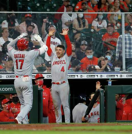 Los Angeles Angels Shohei Ohtani (17) celebrates his home run off of Houston Astros pitcher Luis Garcia with Jose Iglesias (4) during the eighth inning of an MLB baseball game at Minute Maid Park, Sunday, April 25, 2021, in Houston. Photo: Karen Warren, Staff Photographer / @2021 Houston Chronicle