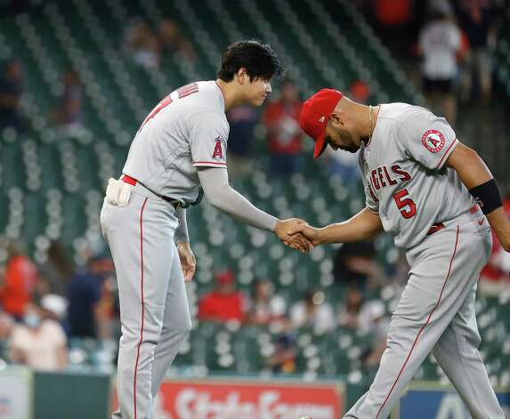 Los Angeles Angels Shohei Ohtani (17) congratulates Los  Albert Pujols (5) after beating the Houston Astros 4-2 after an MLB baseball game at Minute Maid Park, Sunday, April 25, 2021, in Houston. Photo: Karen Warren, Staff Photographer / @2021 Houston Chronicle