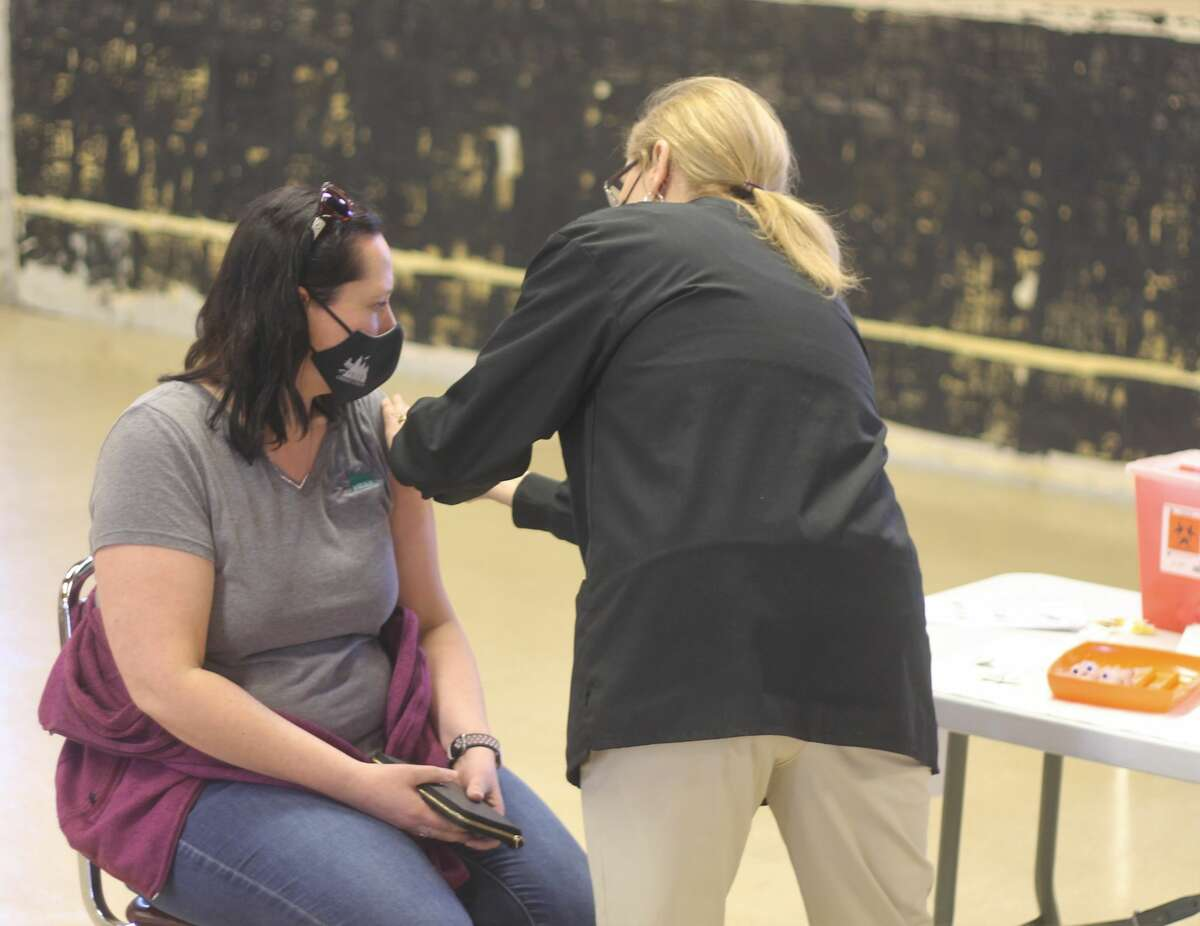 A dose of the COVID-19 vaccine is administered during a clinic hosted by District Health Department #10 at the Wagoner Center in Manistee on Friday. Around 700 people received the vaccine during the event.