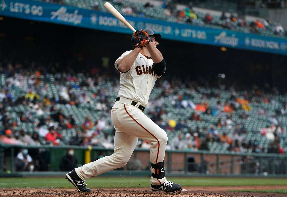 The Giants' Jason Vosler watches his first career hit, a single, in the fifth inning of Sunday's game against the Marlins.