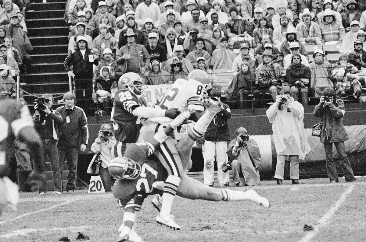 49ers safety and 1981 third-round pick Carlton Williamson (27) and Saladin Martin tackle Cleveland's Ozzie Newsome.