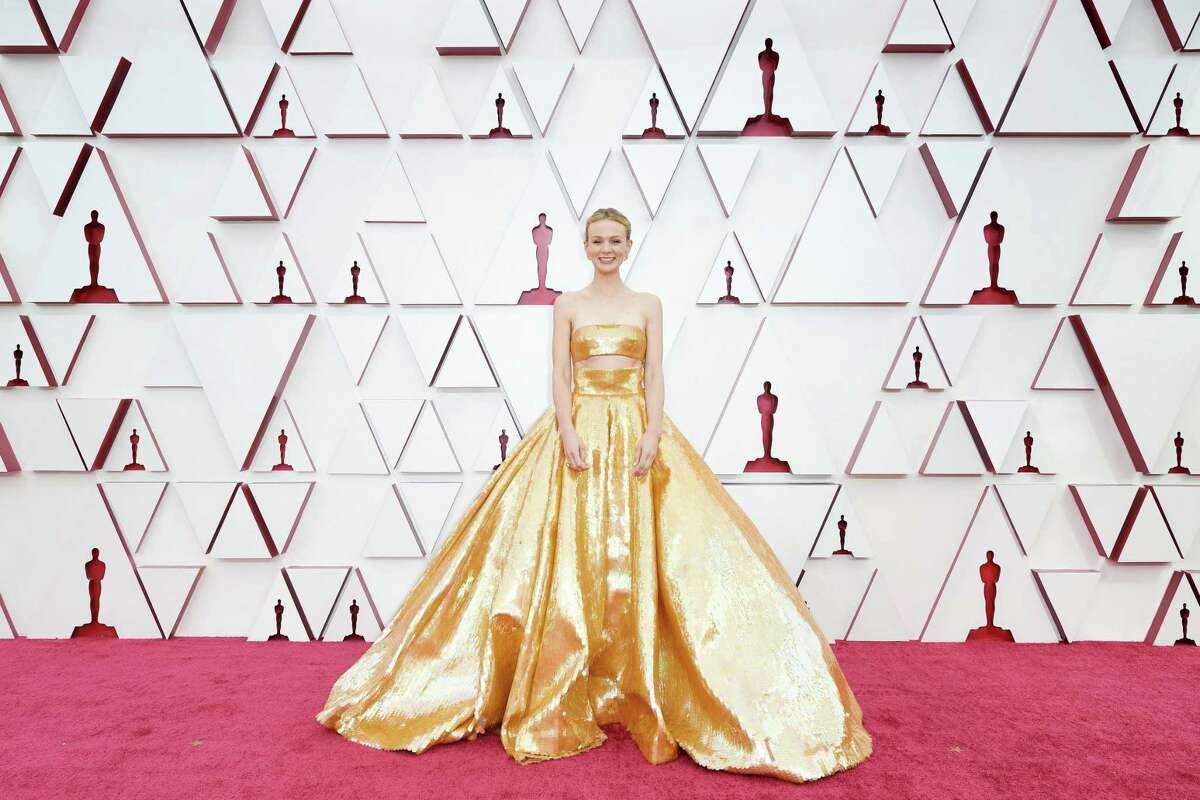 Carey Mulligan dressed in an Oscar-gold crop top and skirt by Valentino at the 93rd Annual Academy Awards at Union Station in Los Angeles.