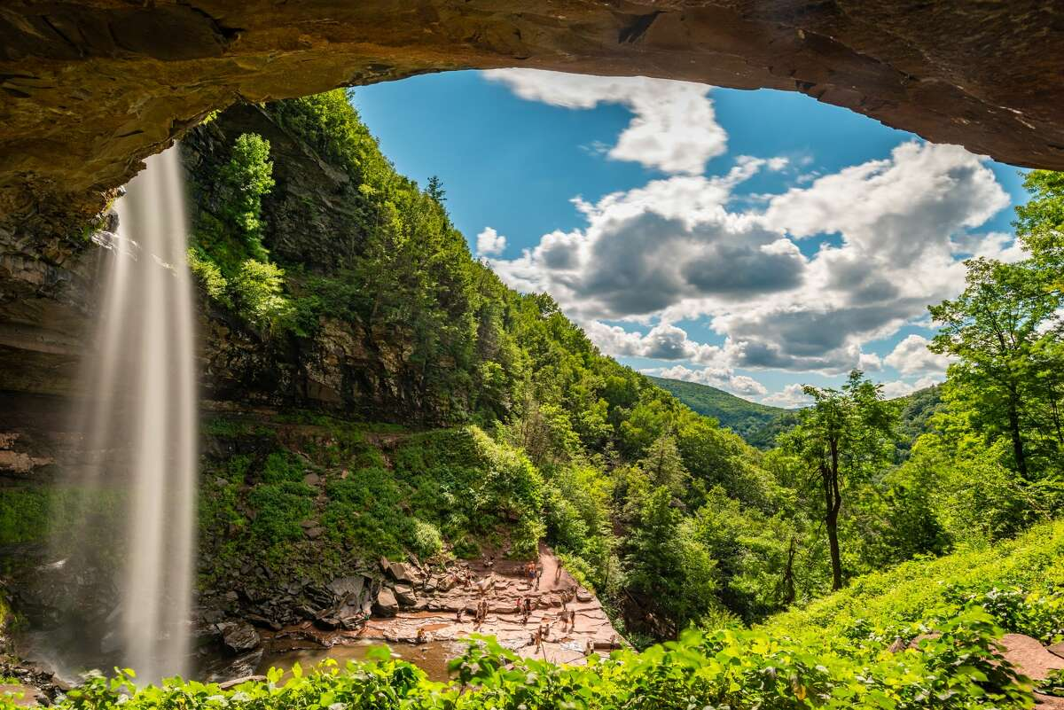 Kaaterskill Falls is a two-stage waterfall in Greene County, NY. A main parking area off Route 23A is now closed to the public in summer 2021.