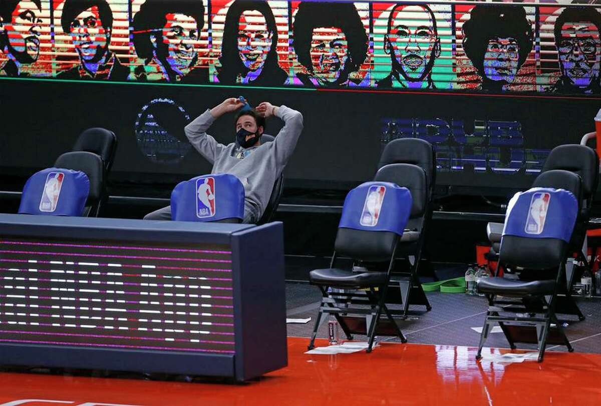 Golden State Warriors' Klay Thompson picks his hair during time out of Warriors' 120-112 win over Miami Heat' in overtime during NBA, basketball game at Chase Center in San Francisco, Calif., on Wednesday, February 17, 2021.