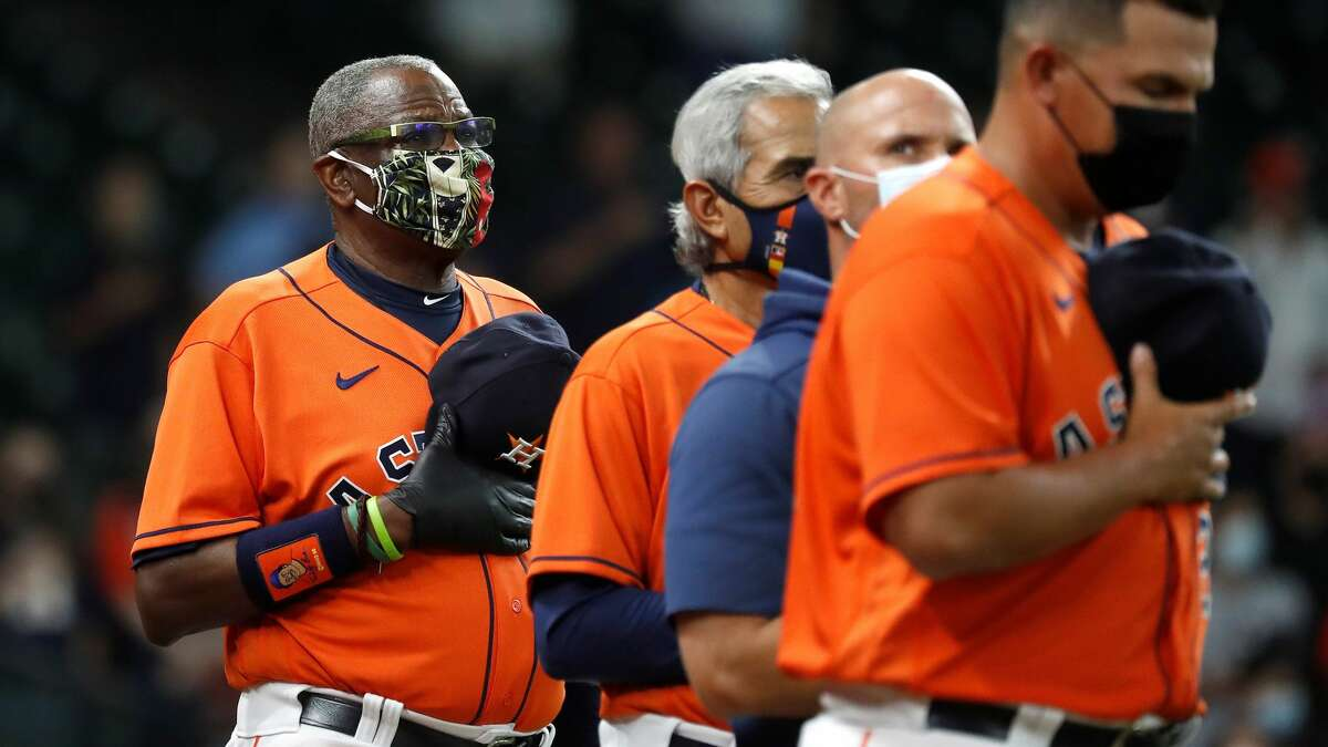 Houston Astros manager Dusty Baker Jr. during the National Anthem before the start of the first inning of an MLB baseball game at Minute Maid Park, in Houston, Friday, April 9, 2021.