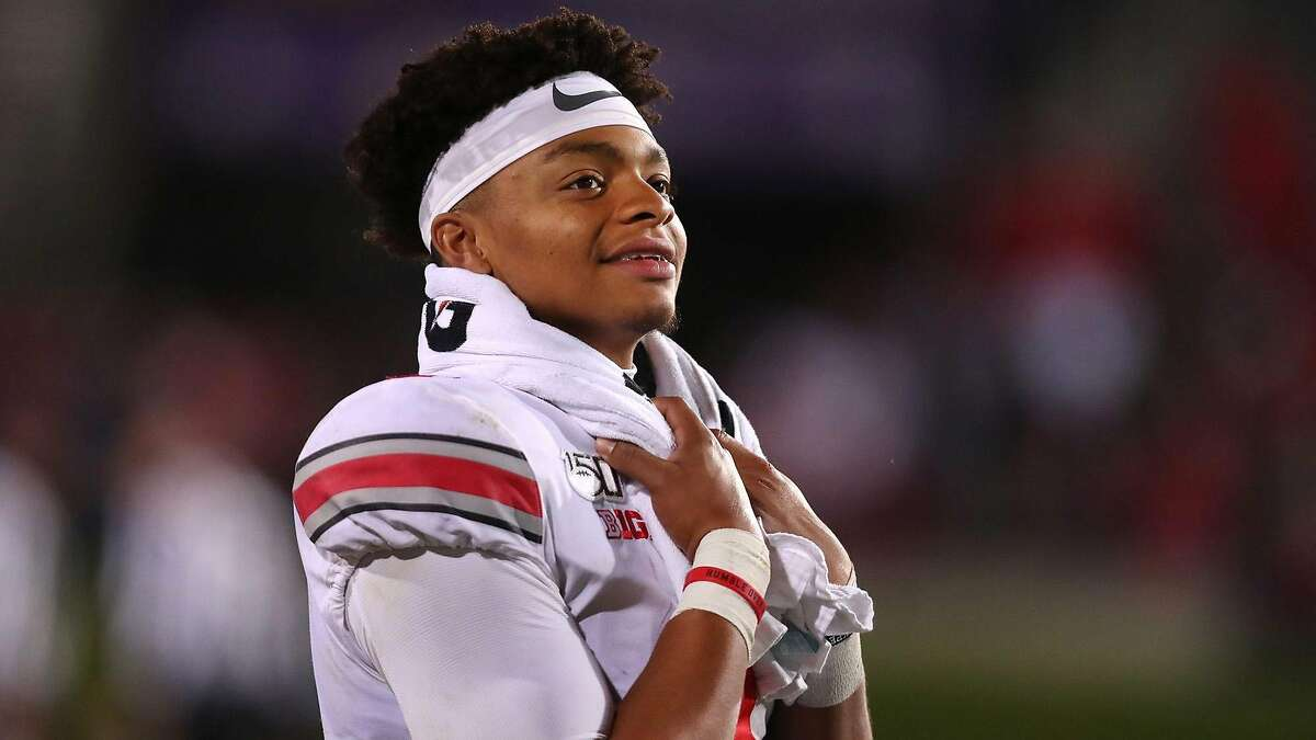 Ohio State quarterback Justin Fields looks on from the bench in the fourth quarter against Northwestern on October 18, 2019, in Evanston, Illinois.