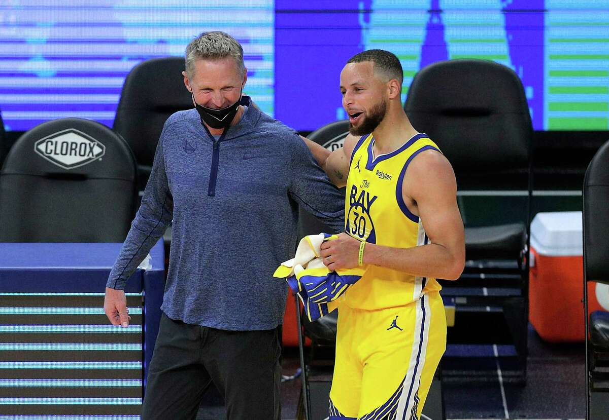 Coach Steve Kerr and Stephen Curry could smile after the Warriors hung on to beat the Sacramento Kings at Chase Center.