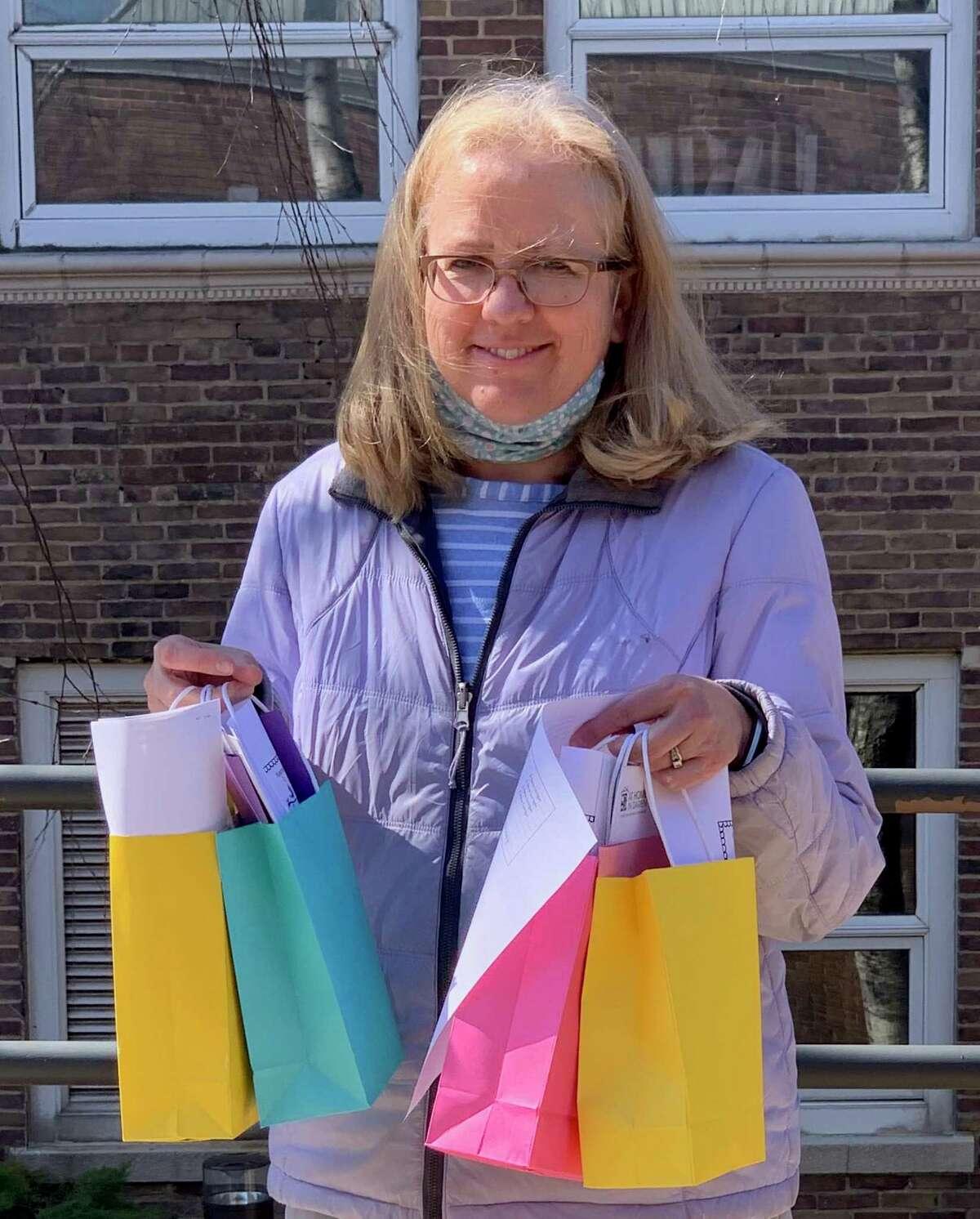 At Home In Darien volunteer Reva Corrigan recently delivered Spring Gift Bags to Darien senior citizens.