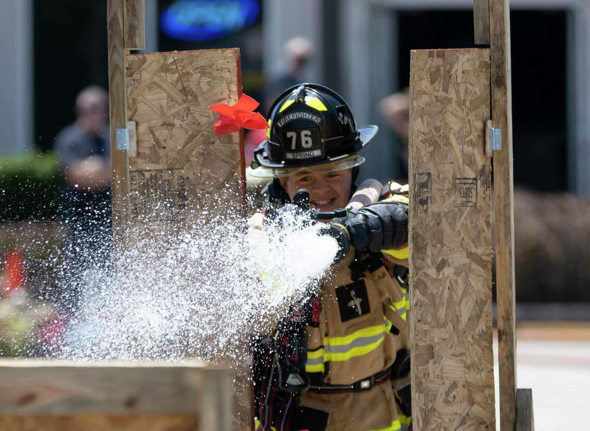 Jakob Ballard with Spring Fire Station 76, competes in the hose drag challenge.