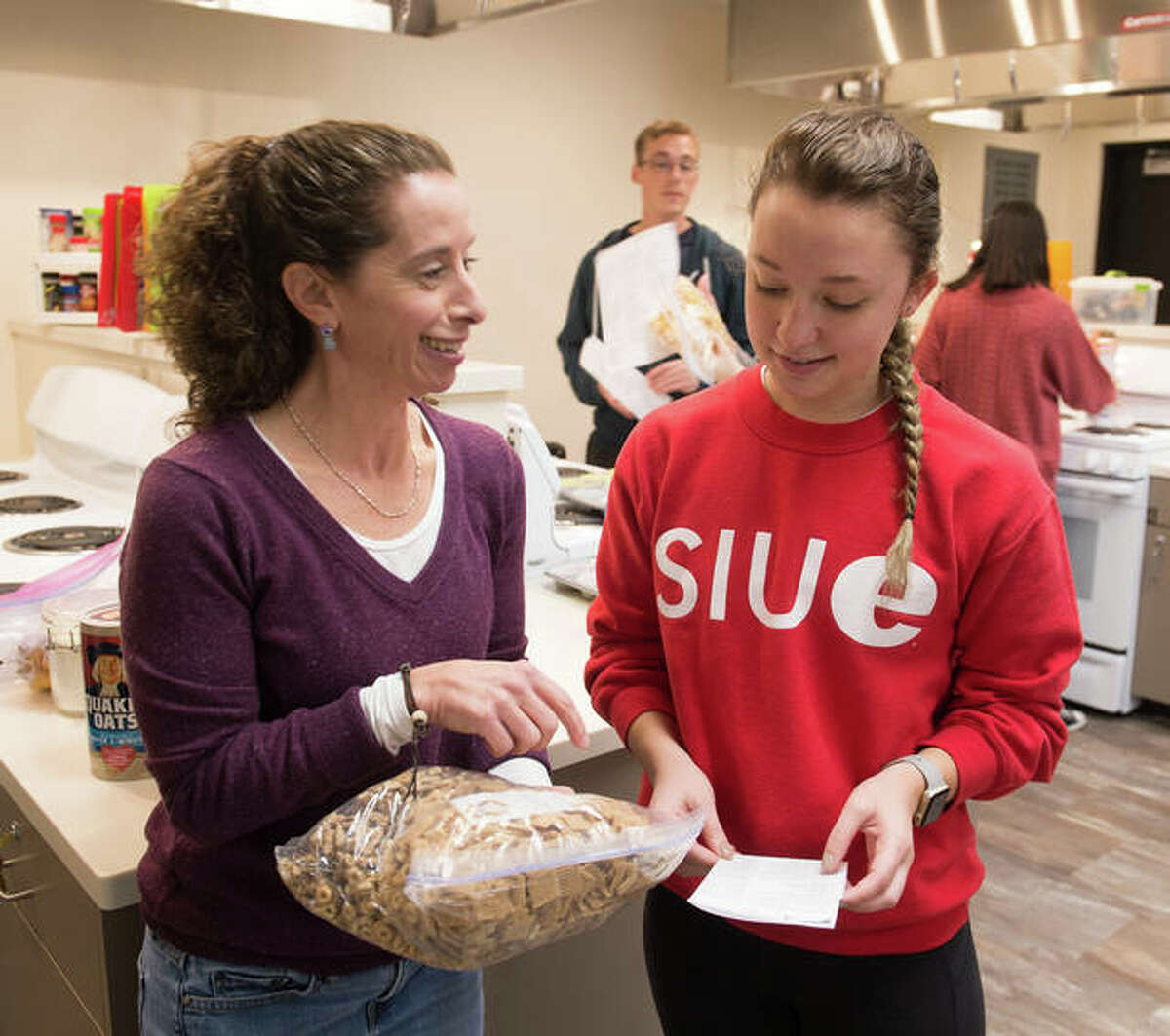SIUE Nutrition Center lab class professor Kathy Mora, left, with Annalise Ankney in November 2017.