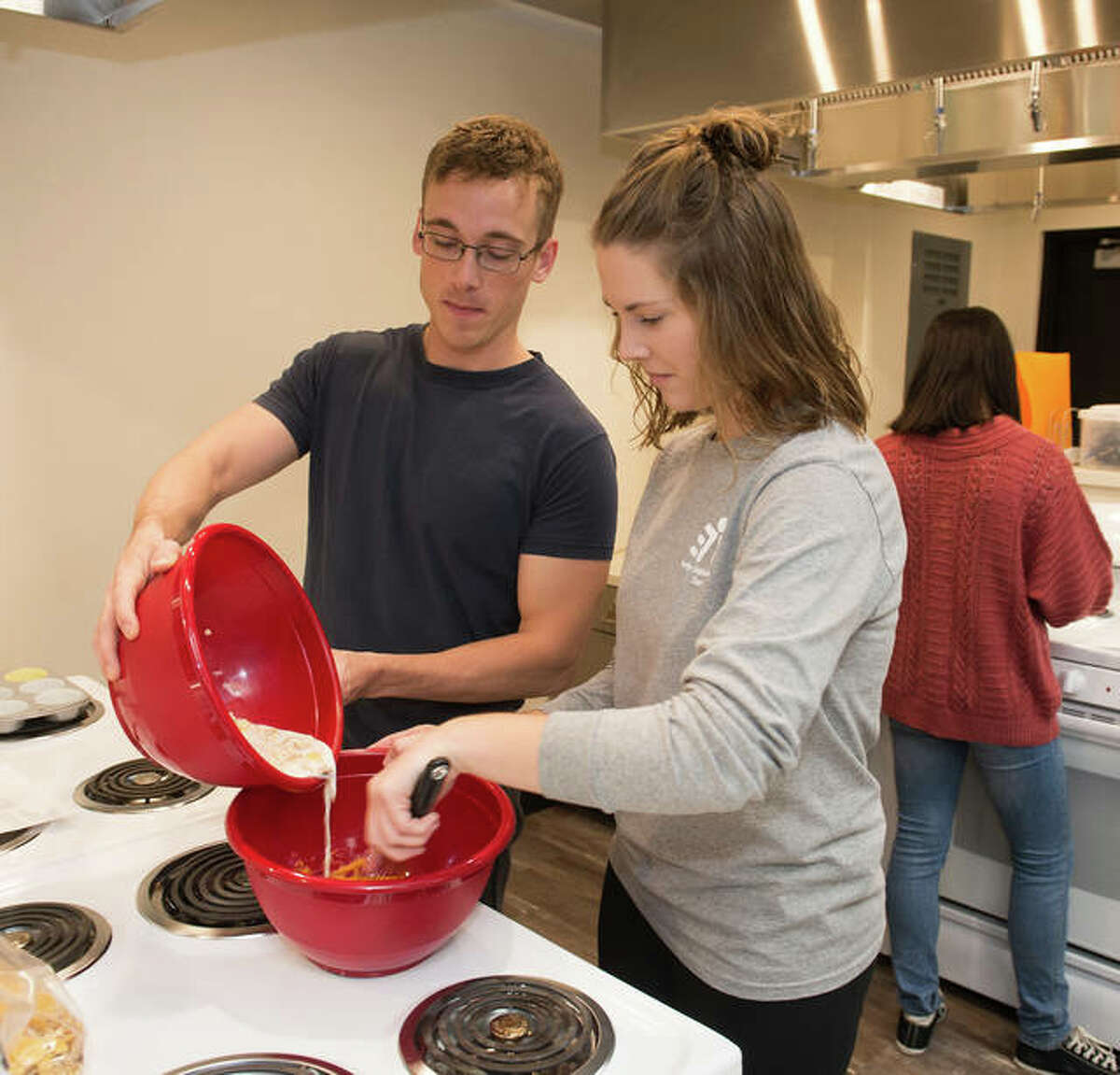 Students Eric Bonacorsi, left, and Alissa Apke during a class in the SIUE Nutrition Laboratory Fueled by the Oberweis Family in November 2017.