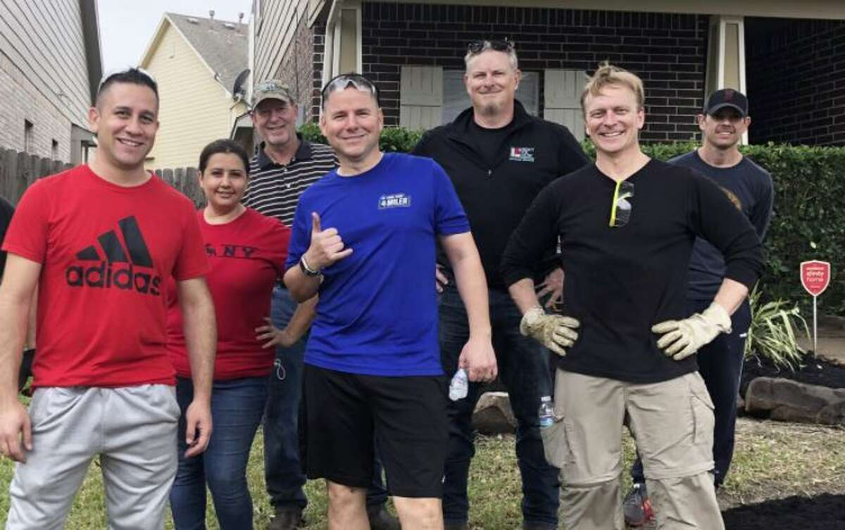 The Stone Gate Guardians use their superpowers to help their neighbors with projects they either can't perform physically or pay for financially and avoid any fines from the home-owners association. From left, Andres Cordona, Maureen Abraham, Mike Hayes, Stuart Fenton, Seth Mitchell, Trey Smith, and Paul Reid.
