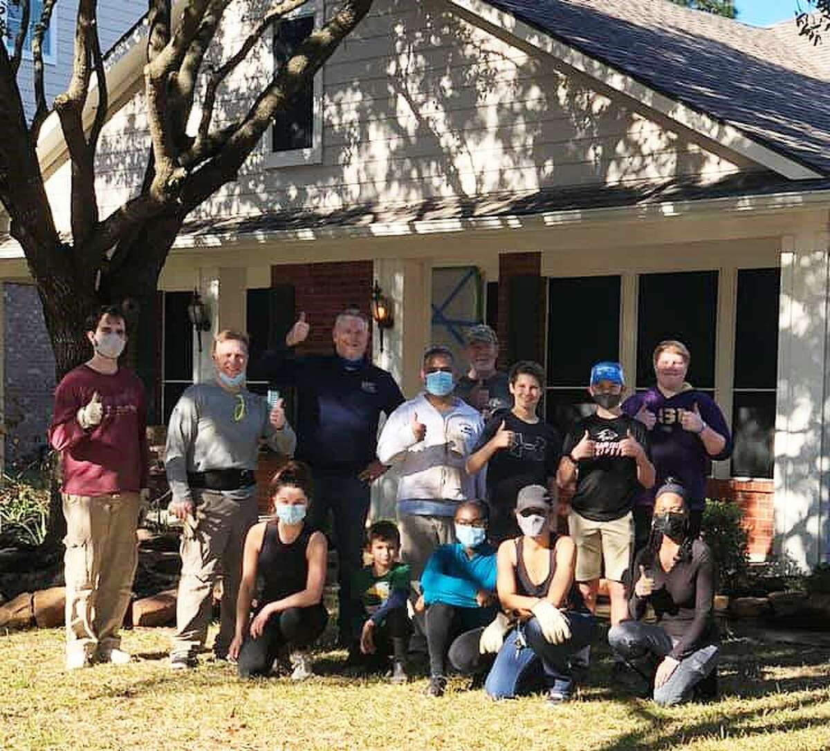 The Guardians take a break following their yeoman's work at the home of a person who requested their help. From left, Kenneth Cargill, Trey Smith, Ellen Smith, Seth Mitchell, Matthew Mitchell, Abraham Santana, Mike Hayes, Rylan Hayes, Tyler Hayes, Jack Deguise,Tina Grimstead Jenkins, Sydnei Grimstead, and Donna Gilliam.
