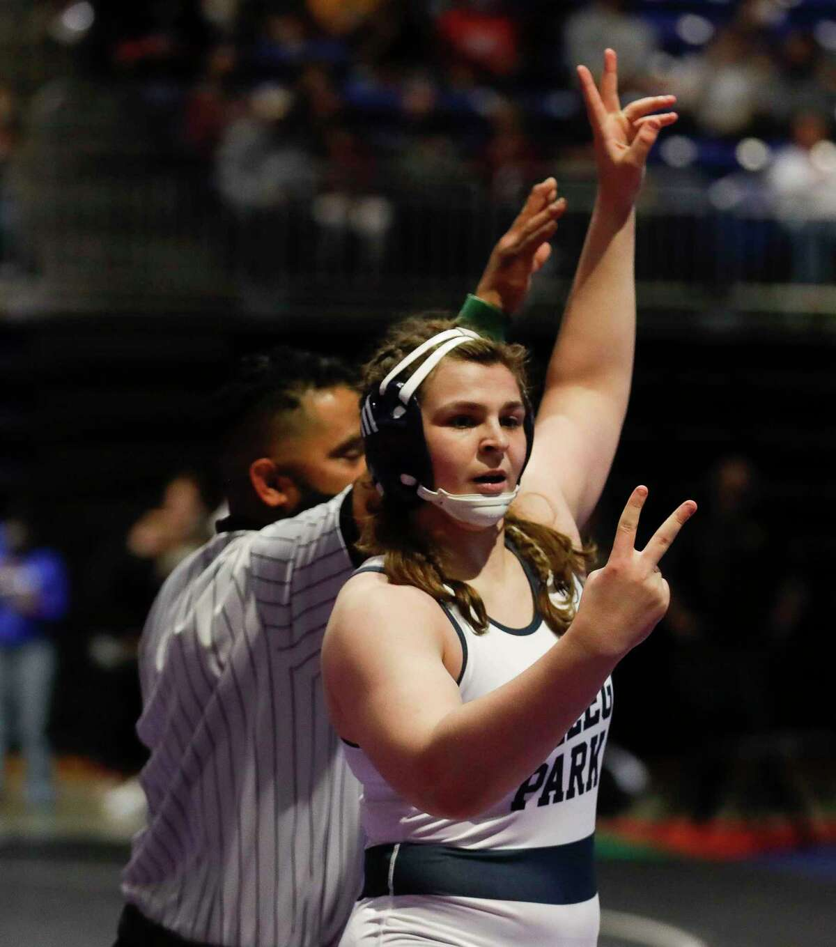 Brittyn Corbishley of College Park reacts after beating Nicole Blinn of Katy Tompkins in the Class 6A girls 185-pound championship during the UIL State Wrestling Championships, Saturday, April 24, 2021, in Cypress.