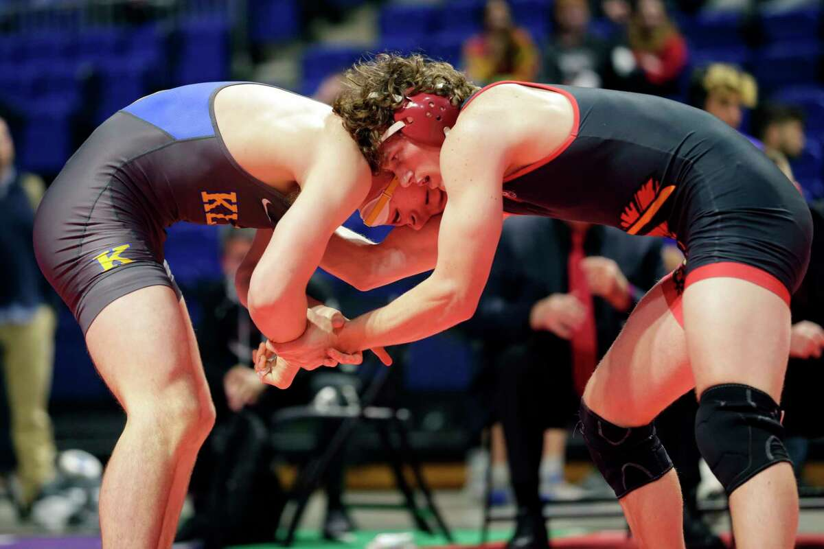 Klein's Eli Sheeren, left, and Euless Trinity's Cameron Bye, right, during their Boys 6A-182lbs championship match of the state high school wrestling championships Saturday, Feb. 22, 2020 at the Berry Center in Cypress, TX.