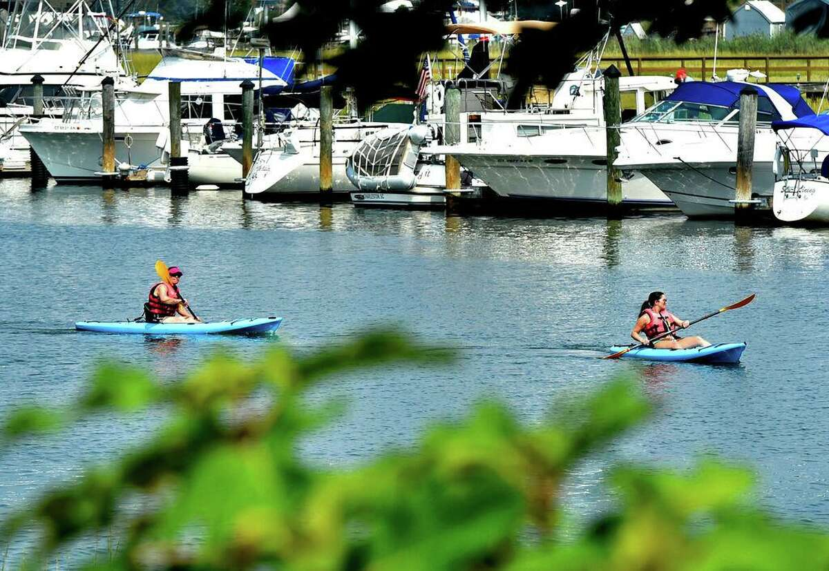 Branford, Connecticut - Monday, August 27, 2018: Kayakers ply the Branford River next to the Harbor Street Bridge by Mill Creek Monday in Branford.