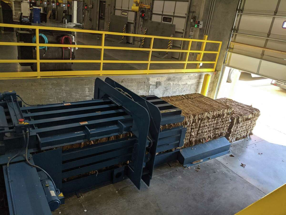Cardboard bales stand ready to be treated at American Furniture Warehouse's recycling facility.